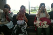 Girls doing their make-up on the train in Japan