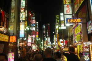 Japanese street at night, signs and neon.