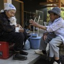 Fukumaru sits with granny and her friend