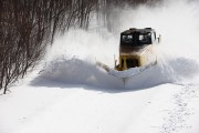 A snow plough begins to clear snow from the recent blizzards in Hokkaido.