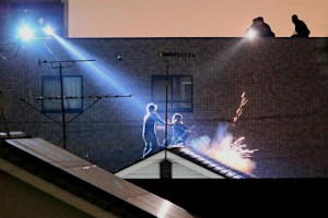 Rooftop drama unfolds as police special investigation team marksmen move in.