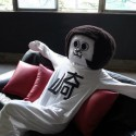 Okasaki mascot 'Okasaemon' relaxes at home.