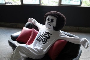 Okasaki mascot 'Okasaemon' relaxes at home.