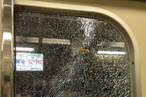 A french fry bursting through train window glass