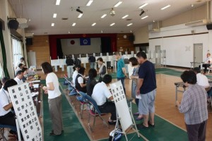 A typical scene at a Japanese polling station. But should voters be allowed to bring their children?