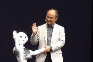 Softbank CEO Son Masayoshi with Pepper, the Japanese robot who can feel emotions.