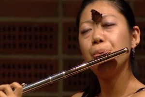 Japanese flautist Oda Yukie plays with a butterfly between her brows