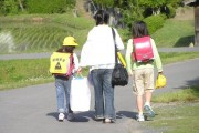 Elementary school students going to school with their mother