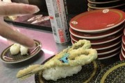 Part time workers deep fry scissors at sushi store