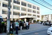 Press gather outside the East Funabashi police station.